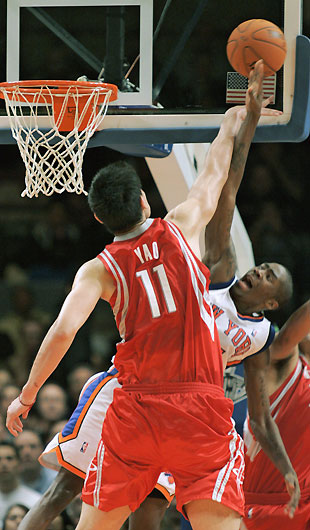 Jamal Crawford has his shot blocked by Houston Rockets center Yao Ming    Yao Ming And Nate Robinson