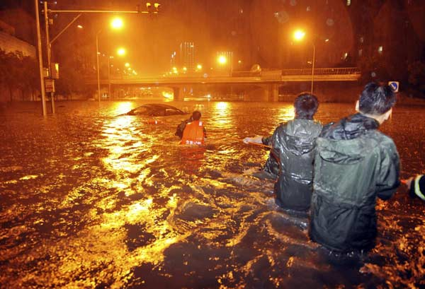 Death toll from Beijing downpours rises to 37