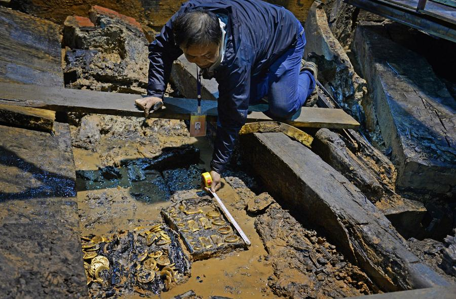 Gold coins, hoofs found in 2,000-year-old Chinese tomb