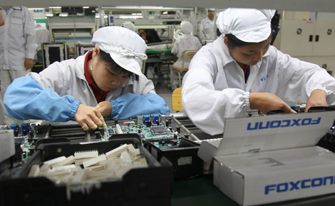 Foxconn vows to reduce hours at factories