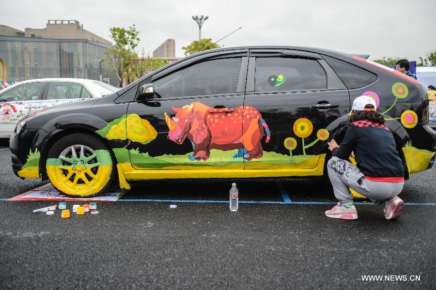 Cars with colorful cartoon drawings parade in Hangzhou[1 ...