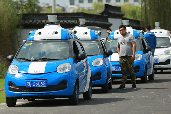 Companies team up to get ahead in autonomous driving race