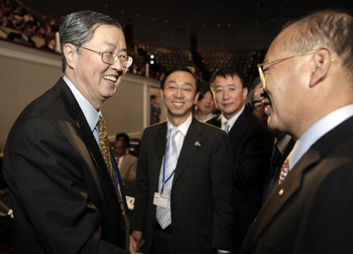 of People's Bank of China Zhou Xiaochuan (L) attends the annual IMF