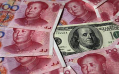 Yuan eases after PBOC widens trading band