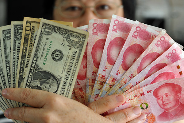 A Forex Trader In Hainan S Qionghai Displays Renminbi And Us Dollars The Chinese Currency Might Continue To Rise Defying Predictions Of Downtrend