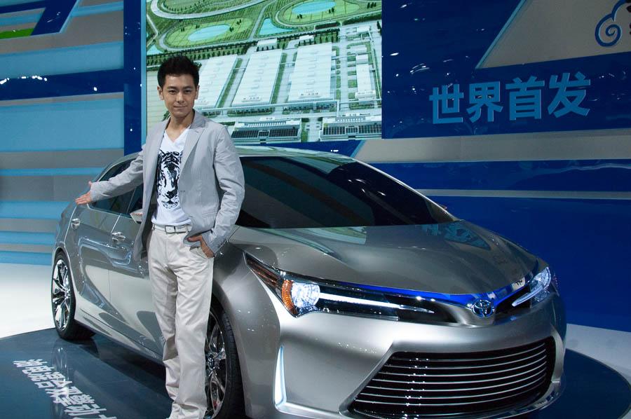 Toyota's spokesman Jimmy Lin Zhiying poses next to Toyota's Yundong