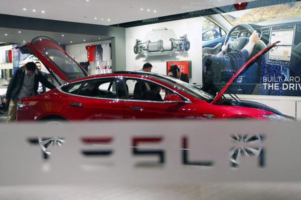 Wait ends for eight as Tesla delivers Model S