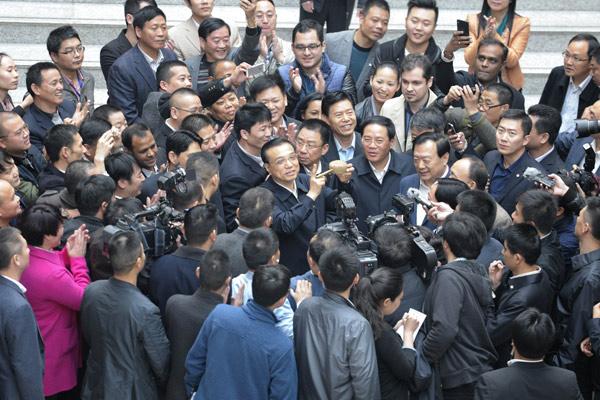 Premier Li highlights key role of e-commerce - Business