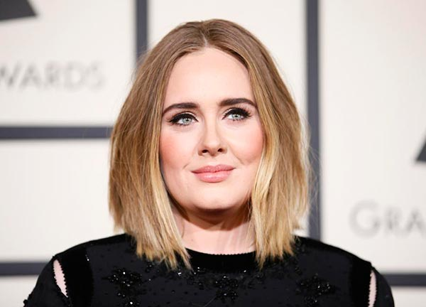 Adele says she battled depression, before and after son's