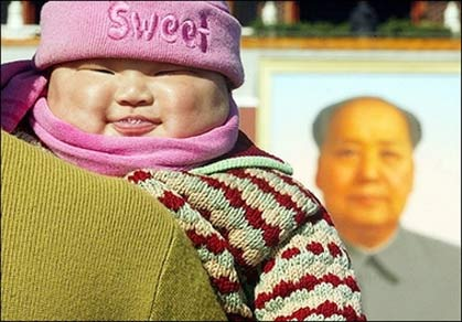 A chubby baby smiling in front of the portrait of former Chinese leader Mao Zedong at Tiananmen Square in Beijing, in 2002. China as a nation has grown in stature since unleashing its economy more than two decades ago but so have its people, who are getting taller and heavier, state media reported.(AFP