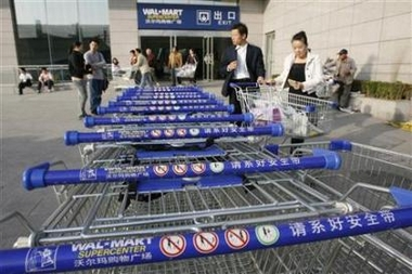 Shoppers emerge from a Wal-Mart Supercenter branch in Beijing October 17, 2006.