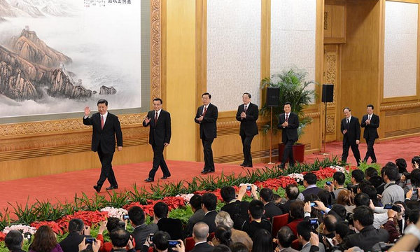 Xi leads top leadership to meet press