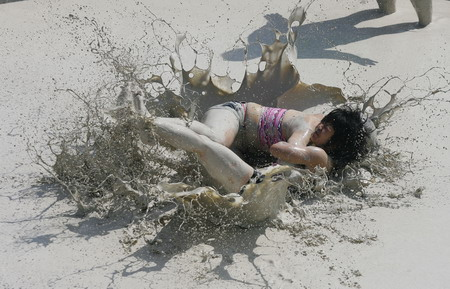 Mud and guts in womens mud wrestling contest