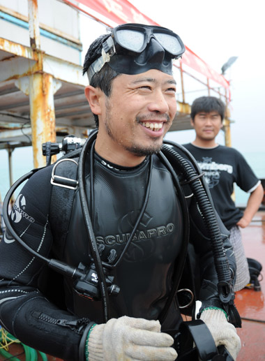 Liu Zhiyuan, a 34-year-old underwater archaeologist, is fresh out of water on the workboat excavating the 400-year-old sunken ship Nan'ao No 1 near Nan'ao Island in Guangdong