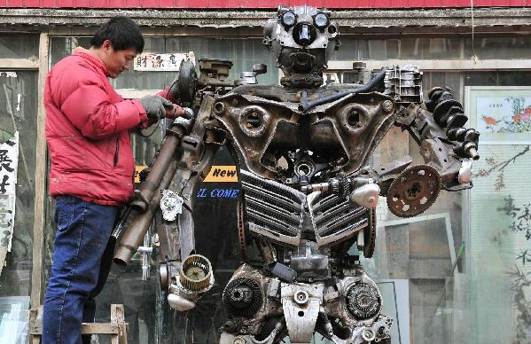 Chinese makes 'transformers' from discarded auto parts