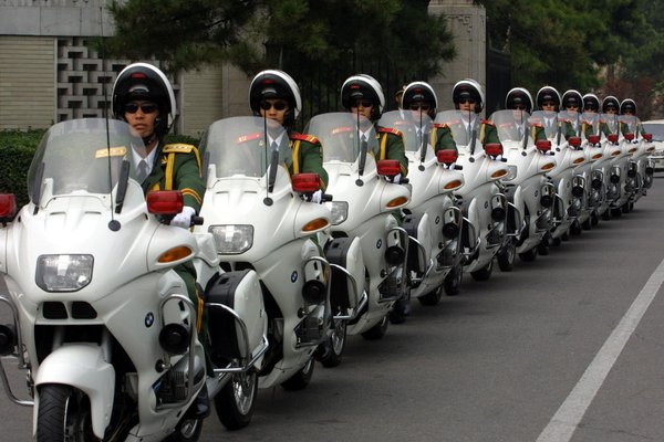 China resumes motorcycle escorts for foreign leaders