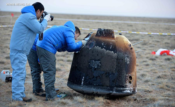 China's unmanned lunar orbiter returns home