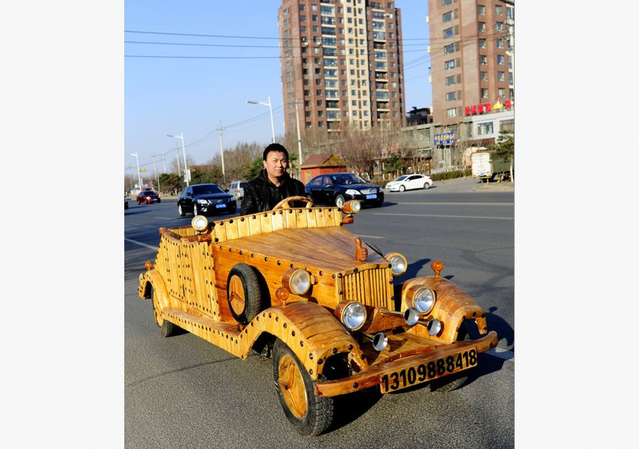 Chinese man makes antique car out of wood[1]- Chinadaily.com.cn