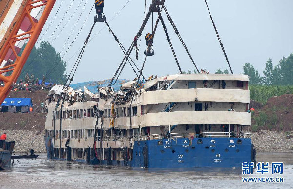 Sunken ship lifted as search for the missing continues