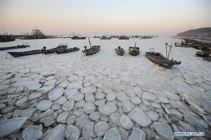 Sea ice traps boats as cold wave sweeps across East China ...
