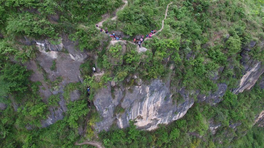 Children scale 800-meter cliff on way to school