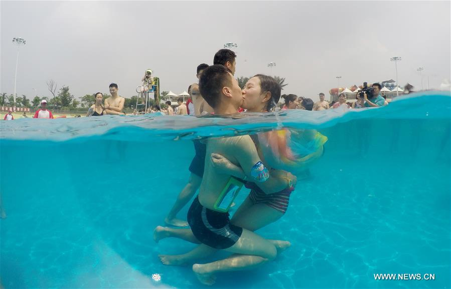 underwater water park. Couples Participate During An Underwater Kiss Contest Held At A Water Park In Shanghai, July 17, 2016.[Photo/Xinhua]
