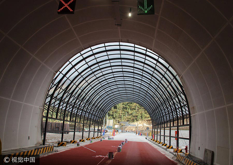 World's highest highway tunnel opens in SW China
