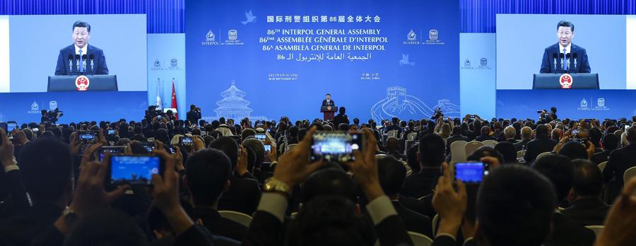 Xi pledges to help strengthen Interpol