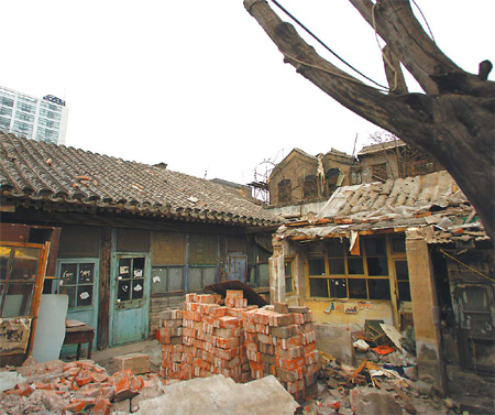 Former residence of late Chinese scholar Kang Youwei (1858-1927) stands in debris. Photo credit Zou Hong