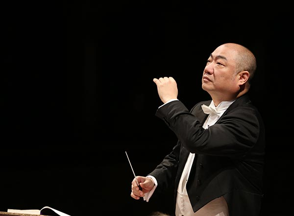 Pianist Xu finds it natural to grasp the baton