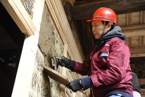 Professor joins hands in ancient architecture maintenance