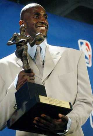 Minnesota Timberwolves Forward Kevin Garnett Holds Up The Maurice Podoloff Trophy After Being Named NBAs Most Valuable Player In Minneapolis Monday