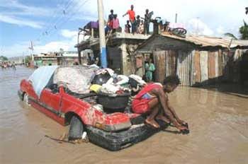 Haitian Families Stay Outside Of Their Houses After Flooding And Mudslides In Gonaives Haiti Monday Sept 20 2004 Receding Floodwaters Raged Through