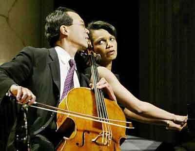 Condoleezza Rice accompanies cellist Yo-Yo Ma on the piano during the