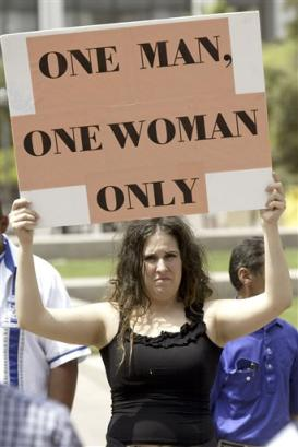 Ammie Graves of San Francisco protests the issue of same-sex marriage during ...