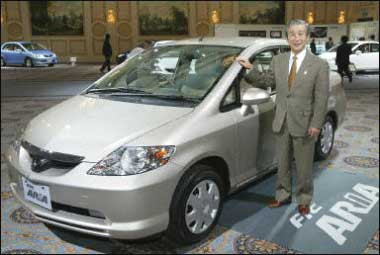 Motor Co Poses With The Companys Small Sedan Honda Fit In This Undated File Photo Japanese Car Manufacturer Is To Export China Made Cars
