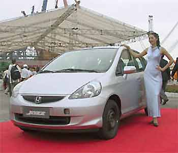 A Model Poses Next To Honda Jazz During Ceremony See Off The First