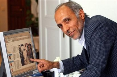 Iranian Bijan Adibi, a former hostage-taker points to a photo on screen which shows a U.S hostage and an Iranian during the 1979 seizure of the U.S. Embassy in Tehran, on Thursday 30, 2005. Adibi, said new president-elect Mahmoud Ahmadinejad 'was not involved.