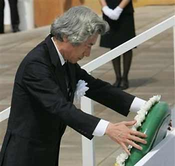 Japanese Prime Minister Junichiro Koizumi places a wreath during the ceremony to mark 60th anniversary of the atomic bomb attack in Nagasaki, southwestern Japan, Tuesday, Aug. 9, 2005. 