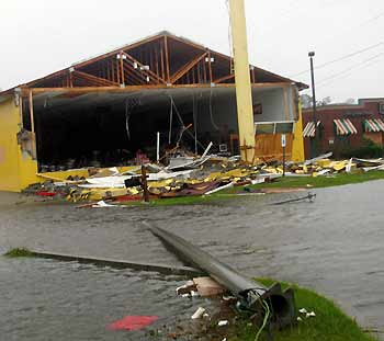 western clothing store (L) is badly damaged while a restaurant next