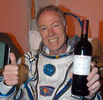 astronaut with wine and thumbs up