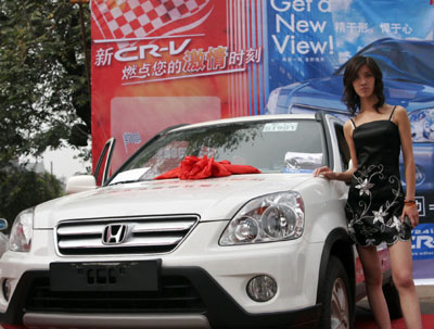 will tax pay of more china cars buyers big/A Honda SUV is on display at a promotional activity. [newsphoto...