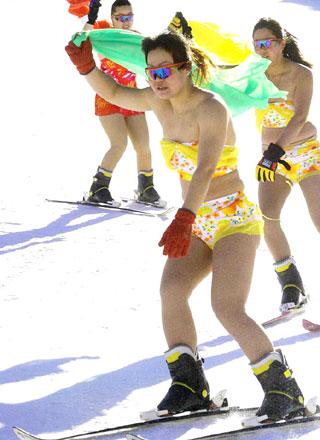 Professional women skiing performers, in bikini,demonstrate skiing skills at ...