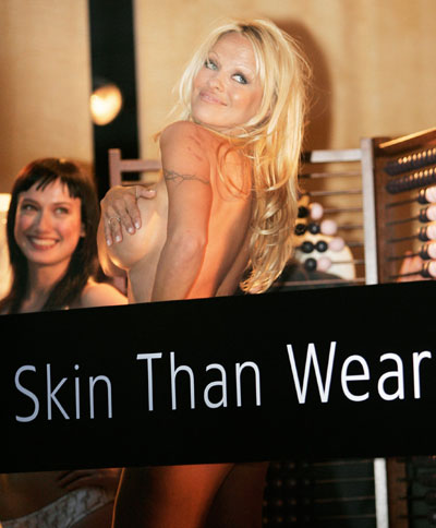 Actress Pamela Anderson stands naked in the front window of fashion designer ...