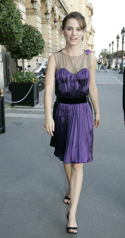 natalie portman glowing in purple in paris