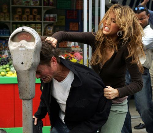 Jessica Alba kicking a...