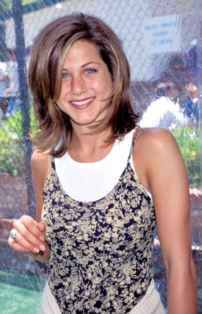 Sporting the haircut that made her a household name, Aniston smiles at the