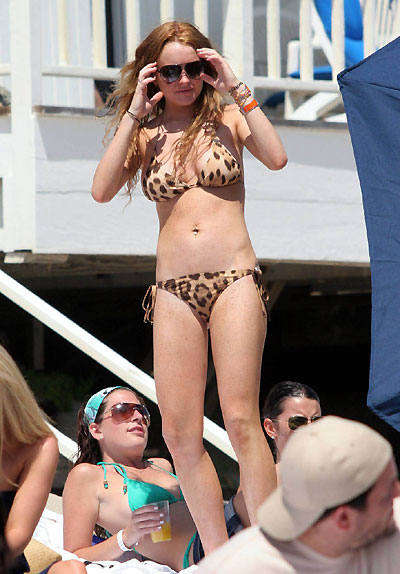Birthday girl Lindsay unwinds on Malibu beach after a weekend of