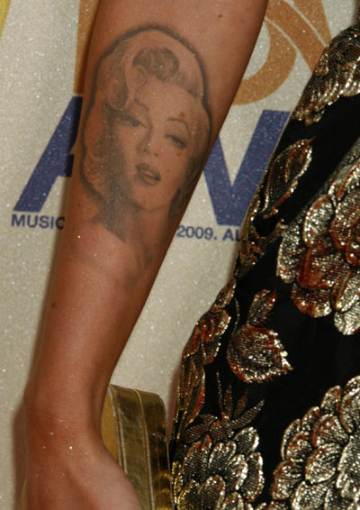 A detail view of a Marilyn Monroe tattoo on the forearm of actress Megan Fox