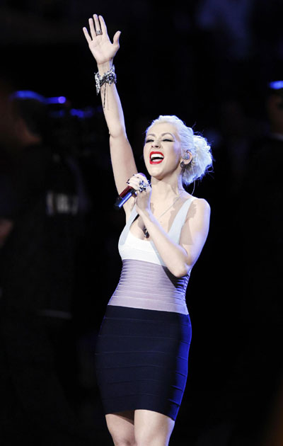 Christina Aguilera performs the national anthem before the Los Angeles Lakers play the Boston ...